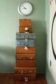 What time is it; its time for a journey?!  Love the vintage luggage.