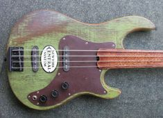 Custom electric guitars and basses made from local and salvaged materials Custom Bass Guitar, Custom Electric Guitars, Guitar Art, Cool Guitar, Rockabilly Guitar, Vintage Bass, Guitar Collection, Game Room Decor, Guitar Building