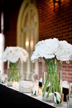 different colorful wildflowers preferred but this is the simple clean centerpieces that looks amazing.