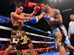 Danny Garcia was able to avoid Lucas Matthysse's heavy blows in his successful title defense. (Robert Beck/SI)