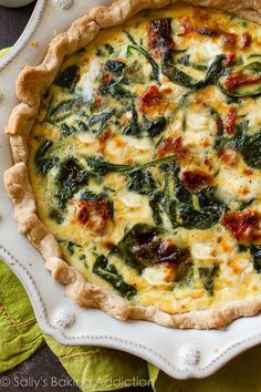 Make an easy and delicious goat cheese spinach & sun-dried tomato quiche for breakfast or brunch using fresh spinach and flavor-packed ingredients!