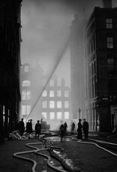 Manchester police and firefighters during the Christmas Blitz, 1940.