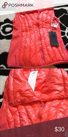 NWT orange vest Never worn. Not Patagonia. Patagonia Jackets & Coats Vests