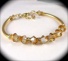 Swarovski Champagne Crystal Bracelet, Golden Shadow Rhinestones Bangle Bracelet Gold Bridal Wedding Jewelry. $48.00, via Etsy.