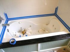 How to Caulk a Bathtub - ..... a must read before you re-caulk your tub!  This was super handy and really helpful, especially filling the tub with water and taping.  I'm not super-handy and it even worked for me.  Grade - A
