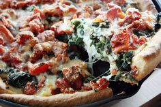 SPINACH TOMATOE DEEP DISH PIZZA WITH LOTS OF CHEESE. by girlversusdough, via Flickr