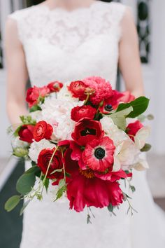 Gorgeous red and white peony, anemone and ranunculus bouquet: http://www.stylemepretty.com/rhode-island-weddings/bristol/2016/01/25/colorful-elegant-linden-place-wedding/ | Photography: Emily Delamater - http://emilydelamater.com/