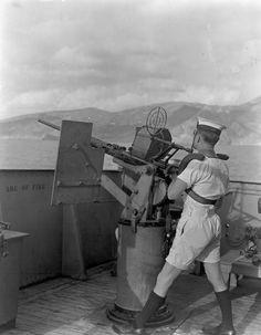 Able Seaman Joe Nantais manning an Oerlikon 20mm anti-aircraft gun aboard HMCS Prince David off Kithera, Greece, 16 September 1944