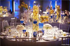 Yellow and Blue wedding centre pieces. Beauty and the beast colors!