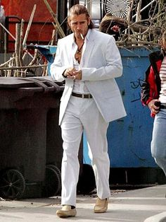 8710fea43d43 Colin Farrell during a publicity shoot for the Miami Vice movie. The photos  couldn t be used because he wore a belt and socks.