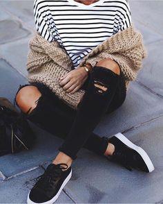 white & black stripes ; tan cardigan ; black ripped jeans ; black sneakers