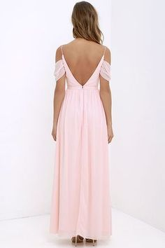 Romantic and utterly enchanting, our Quite the Charmer Peach Maxi Dress will put a bit of magic in every step you take! Slender straps support a lightly padded triangle bodice, made of Georgette fabric that flutters off the shoulder. From a banded waist, gathered accents transition into a full maxi skirt. Hidden back zipper with clasp.