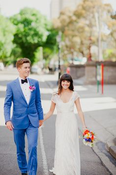 The groom rocks a Pantone royal blue suit for his wedding. the contrast of pink from his carnation boutonniere is a great look.