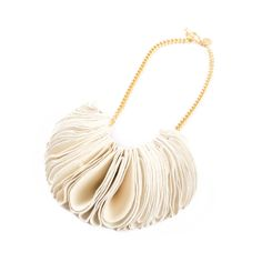Necklace featuring leather, chain and golden brass. Jewels have interesting and voluptuous shapes, they are handmade, engraving and pleating colored leather elements, which, attached, create small or big ruffles. Soft to the touch and with harmonic forms.