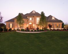 Space and elegance dominates this 4 bedroom luxury home.  House Plan # 161294.
