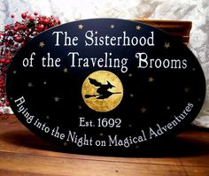 A wonderful handcrafted witch sign, painted on a black worn finish