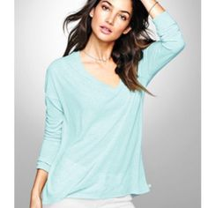 Victoria's Secret Pink long sleeve v-neck Product Details A lightweight v-neck that's perfect for layering. Relaxed fit with a subtle high-low hem.  High-low hem Lightweight cotton blend Side slits at hem Imported cotton/polyester PINK Victoria's Secret Tops Tees - Long Sleeve
