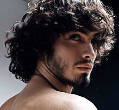men's long curly hairstyle