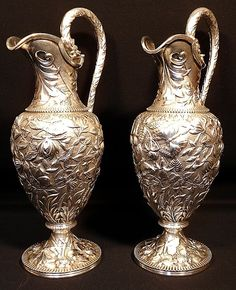 A magnificent pair of repousse sterling silver water pitchers, S. Kirk & Son, MD #SKirkSon