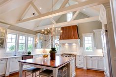 Old Landing Home in Daniel Island, SC by JacksonBuilt Custom Homes Love the wide plank pine floors, vaulted beam ceiling,  wooden top island, and white cabinets.