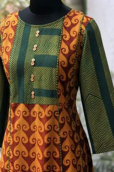 kalidar anarkali with asymmetrical yoke & wooden buttons! main & trim fabric: cotton, handblock printed using the ajrakh technique using natural Simple Kurta Designs, Kurta Designs Women, Salwar Designs, Kurti Neck Designs, Dress Neck Designs, Blouse Designs, Neckline Designs, Kurti Patterns, Designer Blouse Patterns