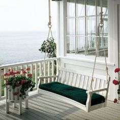 I've often dreamed of owning a cottage by the sea... and a porch swing would make it perfect.