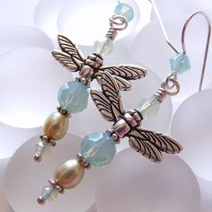 Light Blue and Green Dragonfly Earrings with Swarovski Crystal, Freshwater Pearls, and Rhodium-Plated Wings on Sterling Silver French Wires.. $15.00, via Etsy.