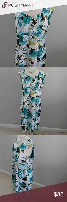 DRESSBARN LOVELY FLORAL PRINT DRESS SIZE 16 DRESSBARN LOVELY FLORAL PRINT DRESS. SO FEMININE AND ROMANTIC. SHADES OF AQUA AND BROWN GIVE A SERENE AND CALMING FEELING. POLYESTER SPANDEX BLEND. MEASURES 20 INCHES FROM ONE ARM PIT TO THE OTHER. MEASURES 40 INCHES FROM TOP OF SHOULDER TO HEM. SIZE 16. Dress Barn Dresses