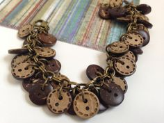 Wooden Buttons Antiqued Gold Charm Bracelet by HighStrungBeading, via Etsy