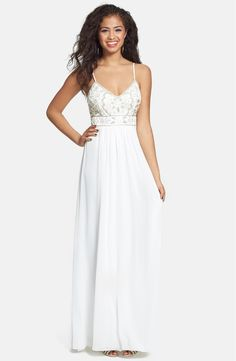 Free shipping and returns on Sue Wong Embellished Empire Gown at Nordstrom.com. Decked out in luminous beads, pearls and ribbons, the spaghetti-strap bodice sets a decadent tone for this brilliant white gown. A long, flowy skirt keeps the style timelessly elegant.