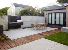 Built-in outdoor furniture elevated off-ground, mixed flooring w-wood, stone, landscaping - San Francisco Dining Terrace modern patio