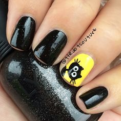 """Halloween Nail Art Black Cats."""" I like this little guy because he reminds me of the cat in one of my favourite films, Coraline. Colors used are #SallyHansen InstaDry in 'Sizzlin' Saffron' and the black is #Orly 'Goth' - it's a black that contains finely-milled silver glitter. Perfect for Halloween nails! Cat is free-handed using @chinaglazeofficial 'Liquid Leather' and 'White on White."""