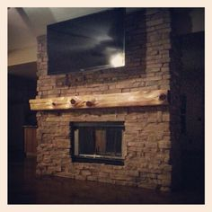 This is like the new house! I'm sure we could fit the tv above the mantle!
