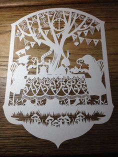 Alice in Wonderland's Mad Hatters Tea Party Paper Cut on Etsy, from £28.00 (template from #bramblecrafts) Etsy - https://www.etsy.com/uk/shop/RosebudPaperCrafts?ref=si_shop Facebook - www.facebook.com/rosebudpapercrafts