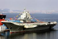 U.S. defense chief, in first, to visit China's aircraft carrier