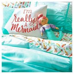 Soothing teal gets the faded treatment in the Ombre Comforter Set from Pillowfort. This comforter and sham set fades from teal to white with teal stripes that incorporate gathering at the edges.