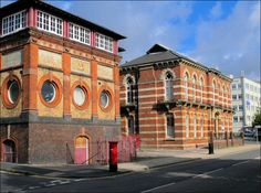 side by side on London Road is the Public Library (opened 1878) and the School of Art (opened in 1860)