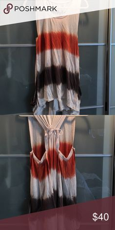 Tie-dye free people tunic Orange, brown, and beige tie-dyed t-back tunic with pockets. Size small free people, worn once Free People Tops Tunics