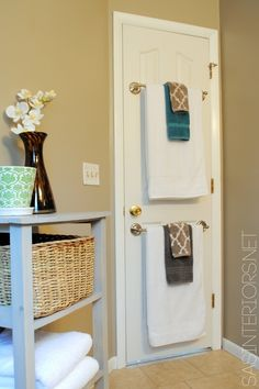 Towel rods on the back of the door... good use of space especially if you don't have a linen closet in the bathroom