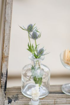 Glass bottles filled with natural florals is a perfect accent for a beach wedding.