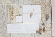 Simple, elegant white and rustic wedding invitation, printed onto white textured card stock. Beautifully finished off with a parcel tied natural