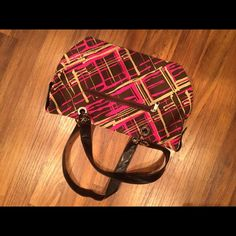 Purse Super cute purse with cool multi-colored design; M sink brown and link and yellow coloring; used twice and in perfect condition Bags Shoulder Bags