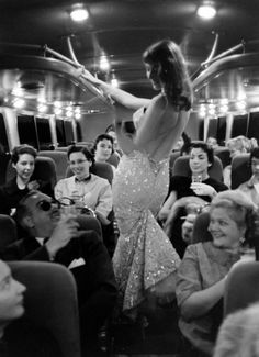 """Vikki """"the Back"""" Dougan by Ralph Crane. She had a habit of wearing the lowest of low-cut, backless dresses."""