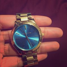 MK gold and blue watch Gold and blue MK watch. Bought about a year ago 8/10 condition. Two links were takin off of the watch Michael Kors Accessories Watches