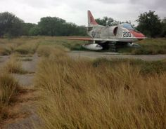 A generous number of large American military airfields feature nearby satellite runways often dating back to World War Two, generally abandoned or used for army combat training. This abandoned A-4 Skyhawk was parked on one in Texas.