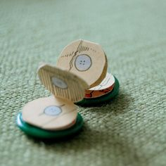 tiny button book! WOW!! cool to make into an ABC book----ooooh, I have lots of buttons!!!