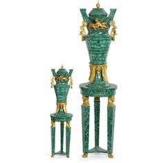 A LARGE PAIR OF GILT-BRONZE AND MALACHITE VENEERED URNS ON PEDESTALS