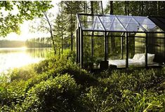 Natural wood floors, glass architecture, and the woodland setting of a Finnish island make this garden house the perfect spot to dream. The greenery of the surrounding area is beautiful, but a storage shed built into the back of the house offers a place to practice your potting skills. Bring your creations indoors where they can flourish along with your imagination since the house is big enough for a cozy bed.