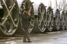 An Ukrainian officer in front of empty nuclear missile containers at the missiles dismantling site in Dnepropetrovsk, February 1999. Ukraine gave up nuclear weapons in 1994 | EPA/Stringer