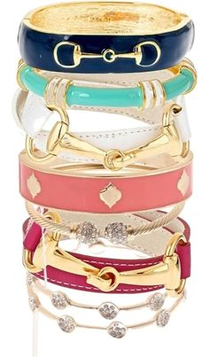 enamel bangles... love the buckle detail